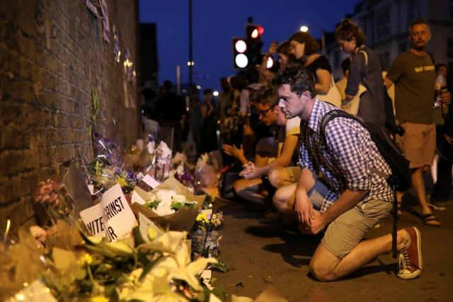 A man looks at messages and tributes left near to where a van was driven at Muslims in Finsbury Park, North London, Britain, June 19, 2017. REUTERS/Marko Djurica