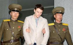 FILE PHOTO - Otto Frederick Warmbier (C), a University of Virginia student who was detained in North Korea since early January, is taken to North Korea's top court in Pyongyang, North Korea, in this photo released by Kyodo March 16, 2016.        Mandatory credit REUTERS/Kyodo/File Photo