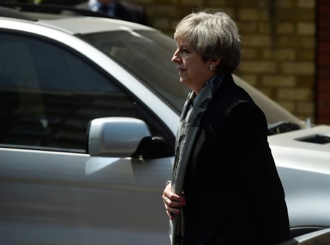 6月22日、北アイルランドのプロテスタント系政党、民主統一党(DUP)の幹部は、メイ英首相が率いる保守党との閣外協力を巡る協議について、29日までに合意する可能性が非常に高いとの見方を示した。写真はロンドンで19日撮影(2017年 ロイター/Hannah Mckay)