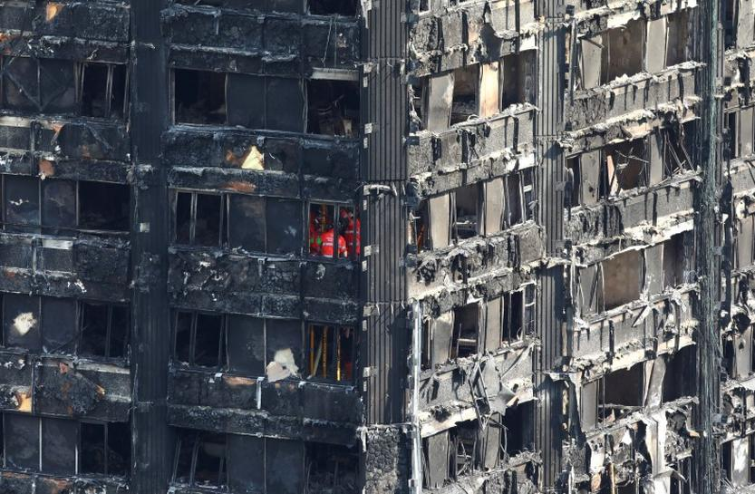 England has 600 buildings with similar cladding to London blaze tower: PM May's spokeswoman