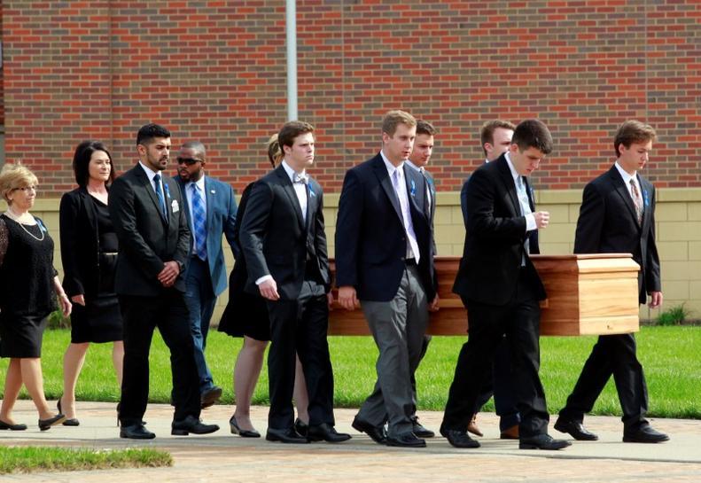 Mourners remember US student held prisoner by North Korea