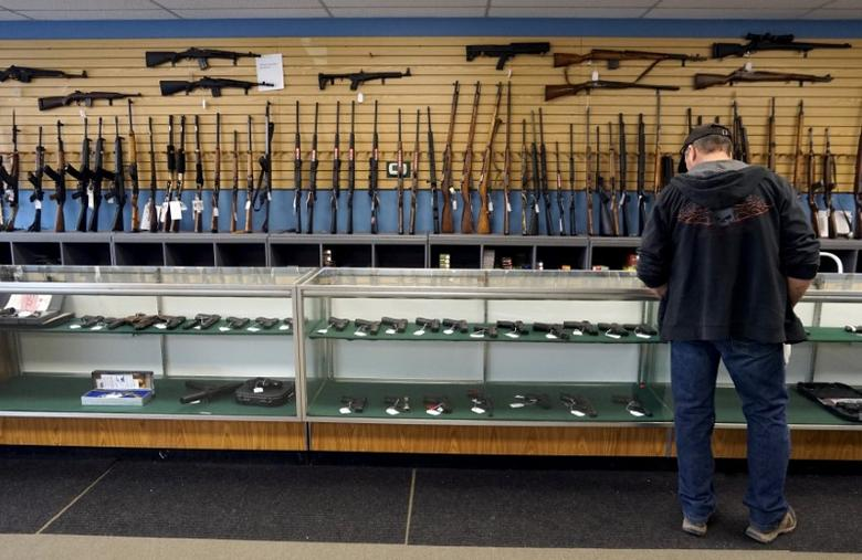 FILE PHOTO: A customer looks over weapons for sale at the Pony Express Firearms shop in Parker, Colorado, U.S. on December 7, 2015.  REUTERS/Rick Wilking/File Photo