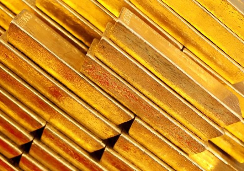 Gold slips, market cautious ahead of U.S. data this week
