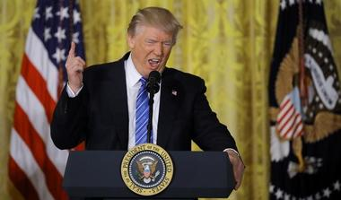 """U.S. President Trump speaks before signing the """"VA Accountability Act""""  in..."""