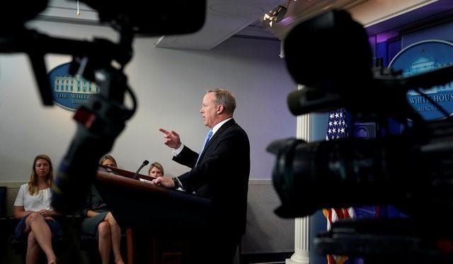 White House spokesman Spicer draws heat off camera