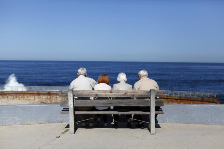 A pair of elderly couples view the ocean and waves along the beach in La Jolla, California March 8, 2012. Mike Blake