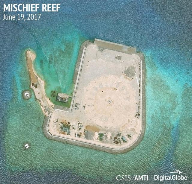 Construction is shown on Mischief Reef, in the Spratly Islands, the disputed South China Sea in this June 19, 2017 satellite image released by CSIS Asia Maritime Transparency Initiative at the Center for Strategic and International Studies (CSIS) to Reuters on June 29, 2017. MANDATORY CREDIT CSIS/AMTI DigitalGlobe/Handout via REUTERS