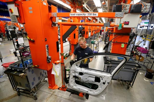 FILE PHOTO: A BMW employee works on the door assembly for the X4 at the BMW manufacturing plant in Spartanburg, South Carolina March 28, 2014. REUTERS/Chris Keane/File Photo