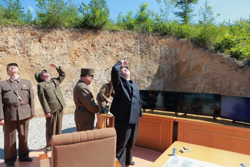 North Korean leader Kim Jong Un looks on during the test-launch of the  intercontinental ballistic missile Hwasong-14 in this undated photo  released by North ...