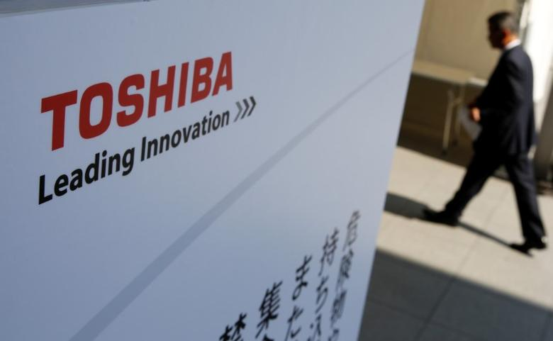 The logo of Toshiba is seen as a shareholder arrives at Toshiba's extraordinary shareholders meeting in Chiba, Japan March 30, 2017. Toru Hanai