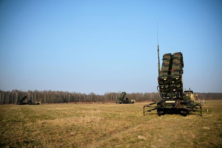 U.S soldiers walk next to a Patriot missile defence battery during join exercises at the military grouds in Sochaczew, near Warsaw, March 21, 2015. Franciszek Mazur/Agencja Gazeta