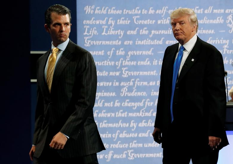 Donald Trump Jr. (L) walks off stage with his father Republican U.S. presidential nominee Donald Trump after Trump's debate against Democratic nominee Hillary Clinton at Hofstra University in Hempstead, New York, September 26, 2016. Brian Snyder