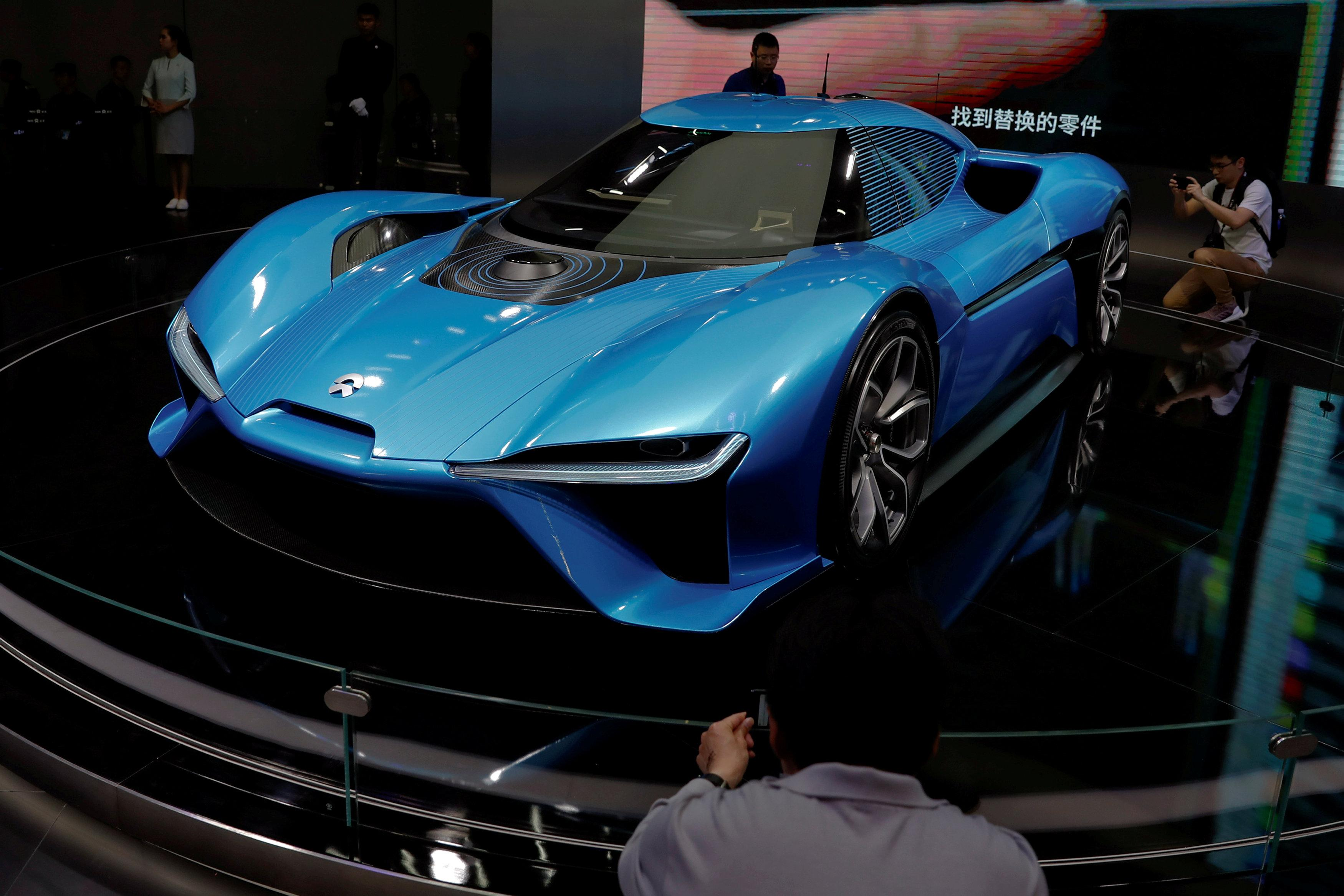 Global automakers call on China to ease impossible electric car ...