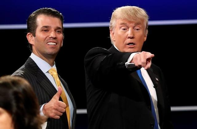 Donald Trump Jr. (L) gives a thumbs up beside his father  Donald Trump (R) after Trump's debate against Democratic nominee Hillary Clinton at Hofstra University in Hempstead, New York, U.S. September 26, 2016.  REUTERS/Mike Segar