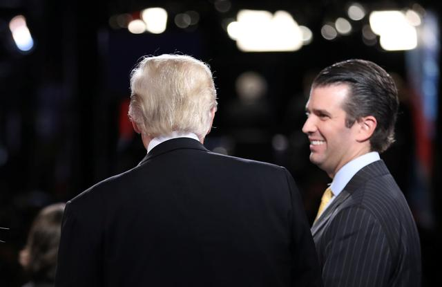 FILE PHOTO: Donald Trump (L) talks with his son Donald Trump Jr. (R) after his debate against Democratic nominee Hillary Clinton at Hofstra University in Hempstead, New York, U.S. September 26, 2016.  REUTERS/Joe Raedle/POOL/File Photo