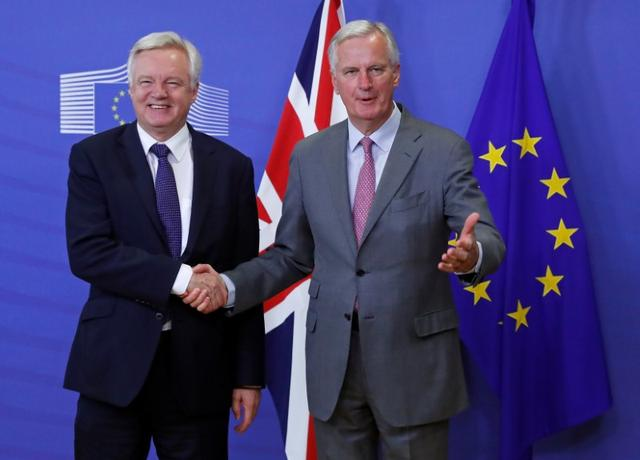 UK Secretary of State for Exiting the European Union David Davis (L) is welcomed by the European Commission's Chief Brexit Negotiator Michel Barnier at the start of a first full round of talks on Britain's divorce terms from the European Union, in Brussels, Belgium July 17, 2017. REUTERS/Yves Herman