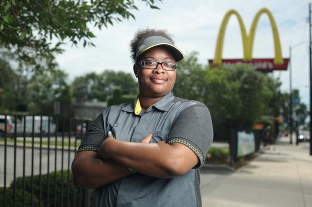 McDonald's employee Ashley Bruce poses in front of the restaurant where she works in Chicago, Illinois, U.S. July 13, 2017. REUTERS/John Gress