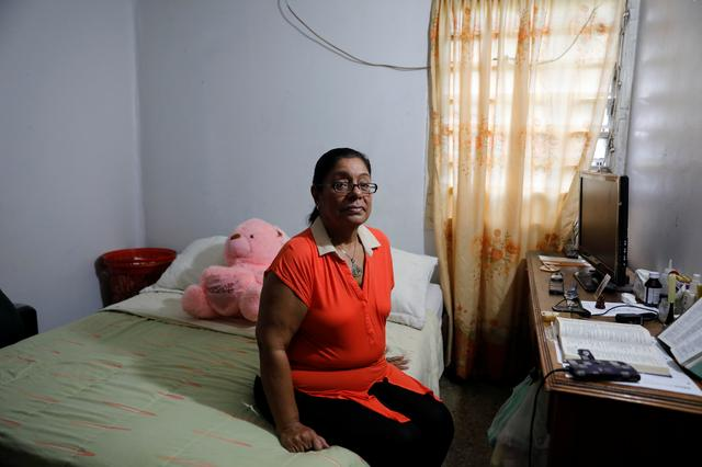 Dilcia Diaz poses for a portrait at her house in an apartment complex of Los Teques, Venezuela, July 14, 2017. Picture taken July 14, 2017. REUTERS/Andres Martinez Casares