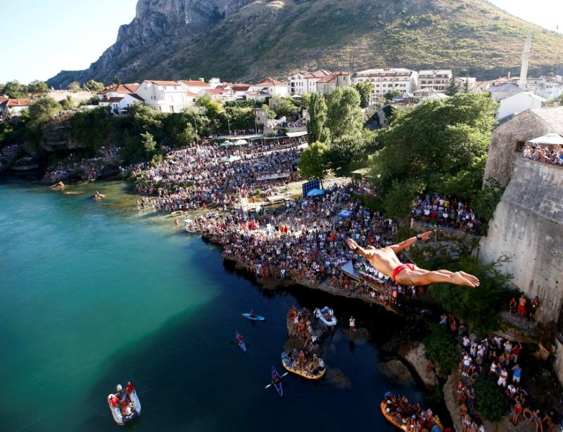Lorens Listo jumps from the Old Bridge during the 451st traditional diving competition in Mostar, Bosnia and Herzegovina. REUTERS/Dado Ruvic