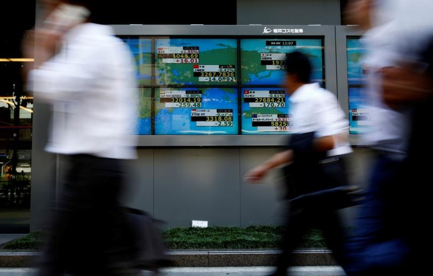 Stocks, dollar extend slide as US, North Korea tensions intensify