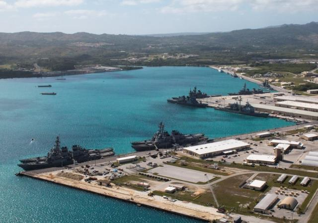 FILE PHOTO: Navy vessels are moored in port at the U.S. Naval Base Guam at Apra Harbor, Guam March 5, 2016.  Major Jeff Landis,USMC (Ret.)/Naval Base Guam/Handout/File Photo via REUTERS