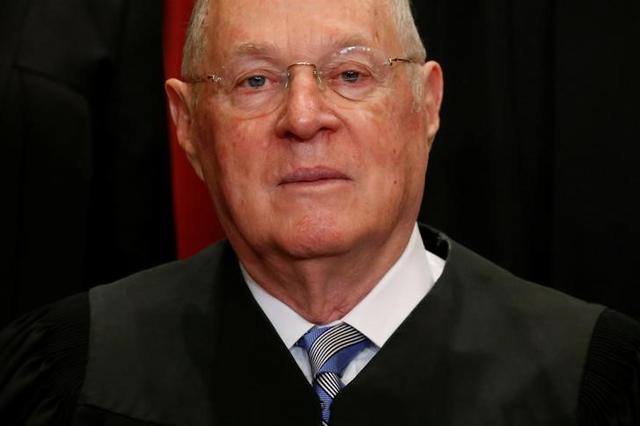 FILE PHOTO: U.S. Justice Anthony Kennedy participates in taking a new family photo with his fellow justices at the Supreme Court building in Washington, D.C., U.S., June 1, 2017. REUTERS/Jonathan Ernst
