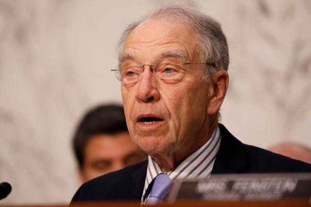 FILE PHOTO: Senator Chuck Grassley (R-IA) asks a question during a Judiciary Committee hearing into alleged Russian meddling in the 2016 election on Capitol Hill in Washington, U.S., July 26, 2017. REUTERS/Aaron P. Bernstein