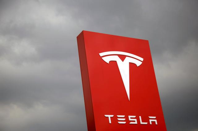 FILE PHOTO - The logo of Tesla is seen in Taipei, Taiwan on August 11, 2017. REUTERS/Tyrone Siu/File Photo