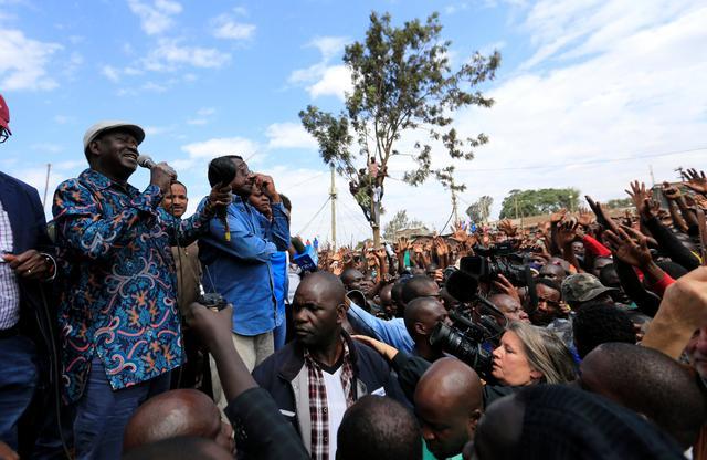 Opposition leader Raila Odinga addresses supporters in the Kibera slum, Nairobi, Kenya August 13, 2017. REUTERS/Thomas Mukoya