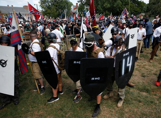White nationalists hold shields as they clash against a group of counter-protesters in Charlottesville. REUTERS/Joshua Roberts