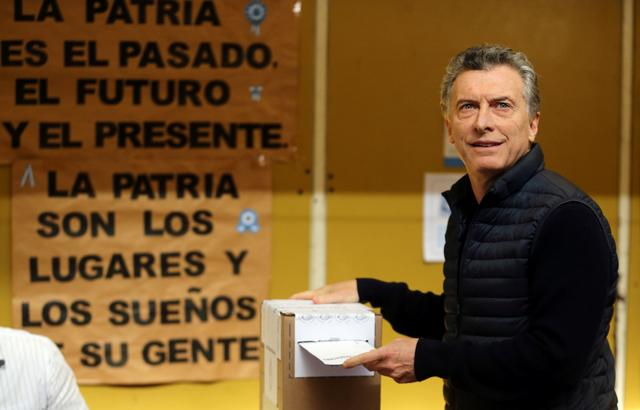 Argentine President Mauricio Macri casts his vote at a polling station in mid-term primary elections in Buenos Aires, Argentina August 13, 2017. REUTERS/Marcos Brindicci