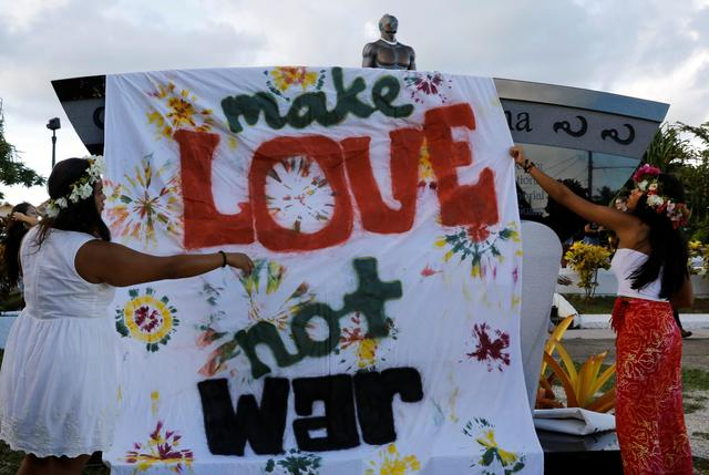 Local residents display a banner during a peace rally at Chief Quipuha Park, on the island of Guam, a U.S. Pacific Territory, August 14, 2017. REUTERS/Erik De Castro