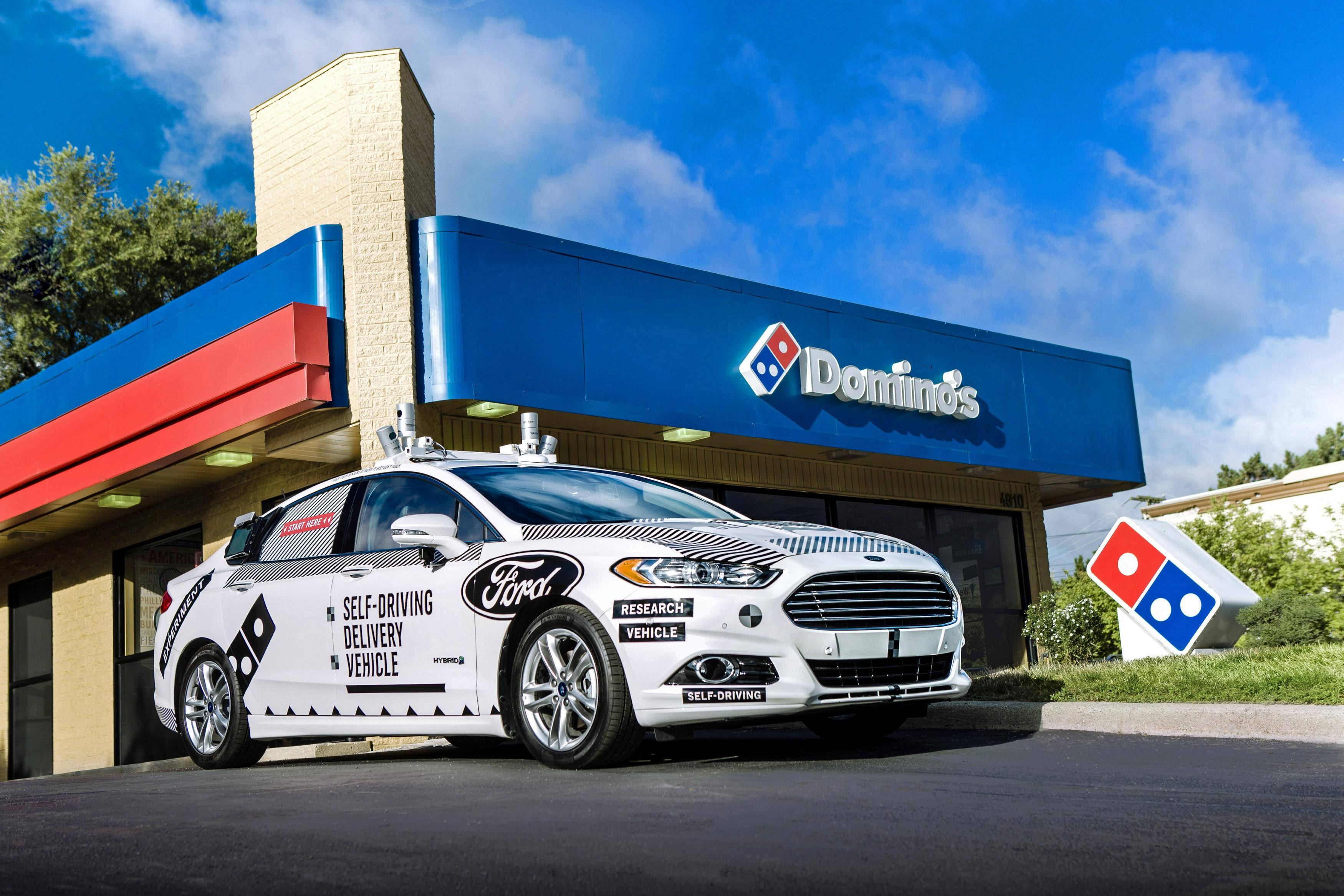 cdb721e5f4 A Ford self-driving delivery vehicle is pictured in front of a Domino s  pizza restaurant in this undated handout photo obtained by Reuters August  28