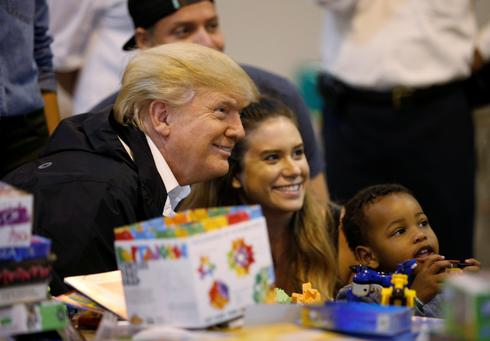Trump visits Harvey evacuees