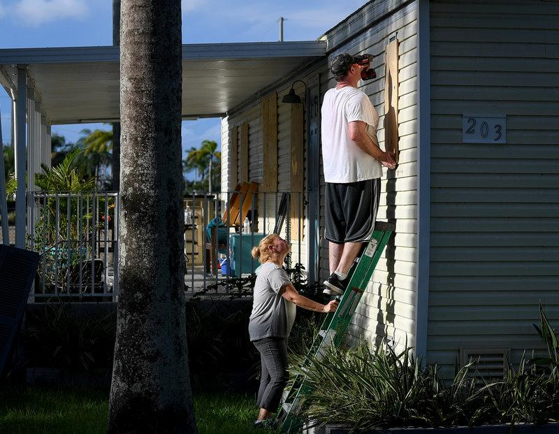 FILE PHOTO Yana And Jeremy Cauble Board Up Their Mobile Home In Preparation For Hurricane Irma Homestead Florida US September 7 2017