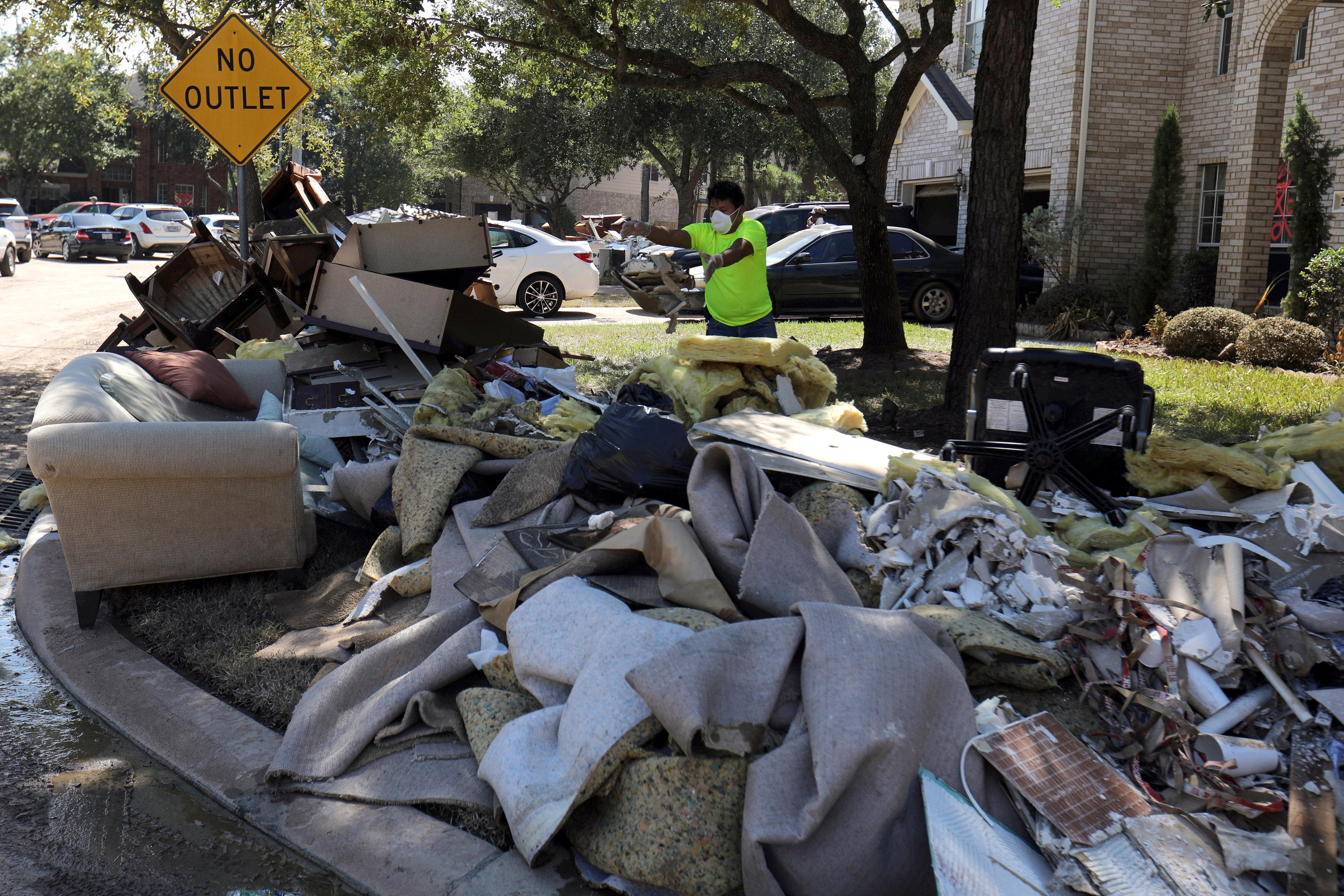 Hurricane-ravaged U S  cities hit by rising cleanup costs