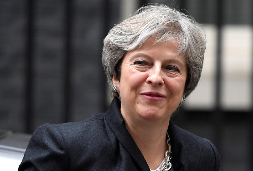 UK PM May tells business chiefs: two-year Brexit transition is assured - source