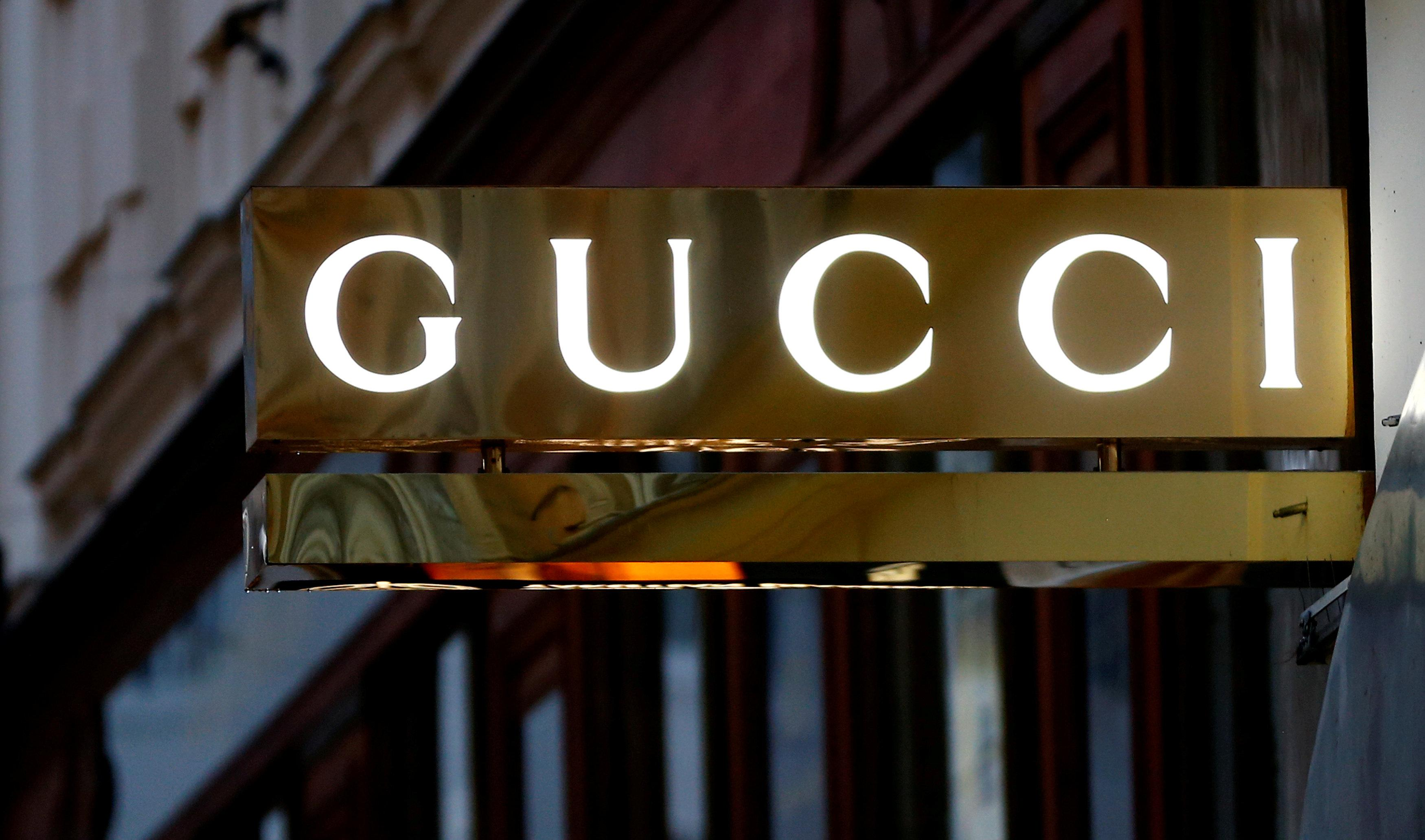 88983f9cf FILE PHOTO  A company logo is pictured outside a Gucci store in Vienna