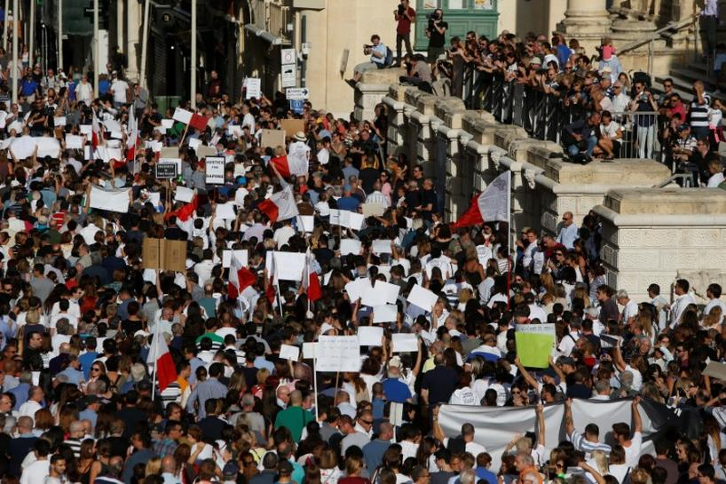 Protesters call for justice after Maltese journalist's killing   Reuters