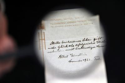 Note with Einstein's theory on life auctioned for $1.3 million