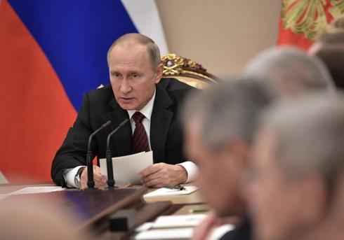 Russia's Putin urges tough action against online extremism