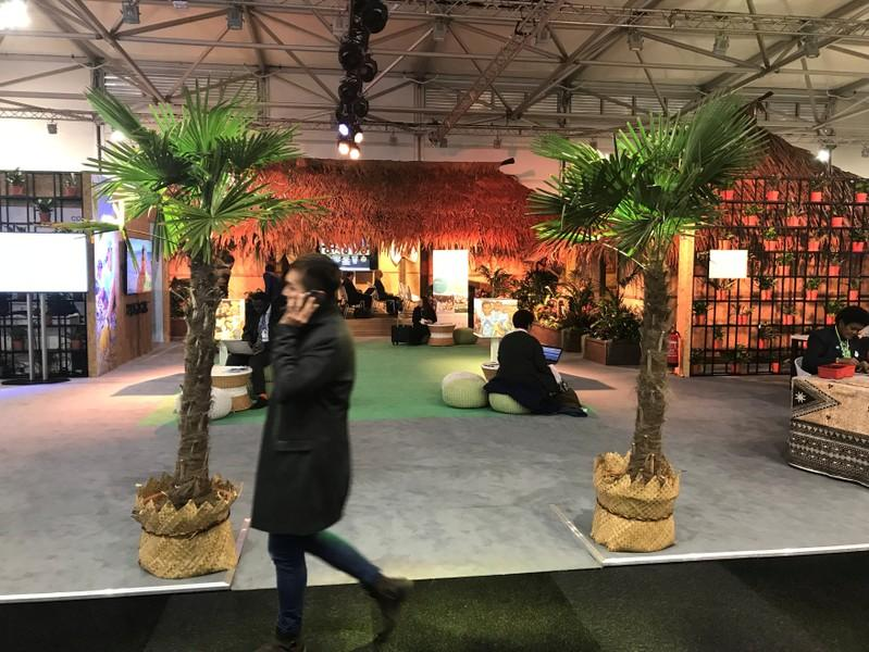 Typical Fiji huts and palm trees are displayed during the COP23 UN Climate Change Conference 2017, hosted by Fiji but held in Bonn, Germany November 9, 2017. Picture taken November 9, 2017.  Alister Doyle