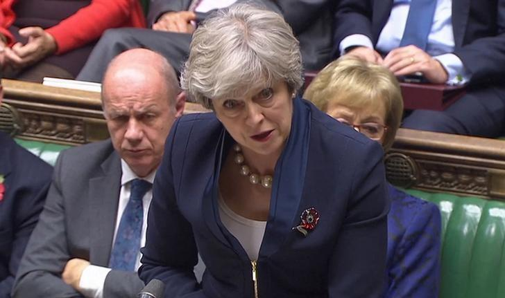 "British Prime Minister Theresa May and her deputy, Damian Green, in the House of Commons, Nov. 1, 2017. Green is fighting allegations of harassment and having ""extreme pornography"