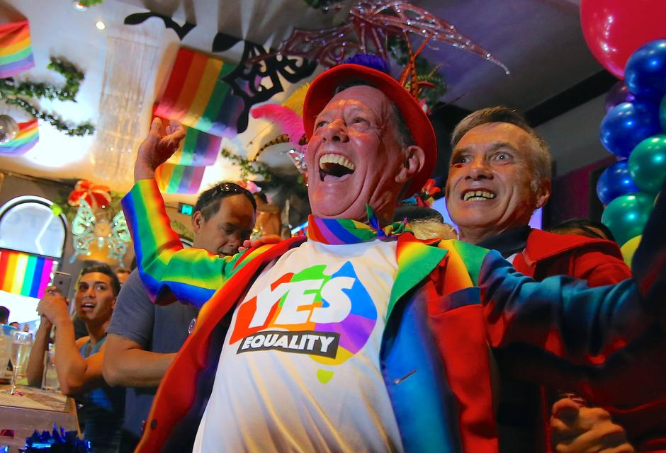 Members of Sydney's gay community react as they celebrate after it was  announced the majority of Australians support same-sex marriage in a  national survey, ...