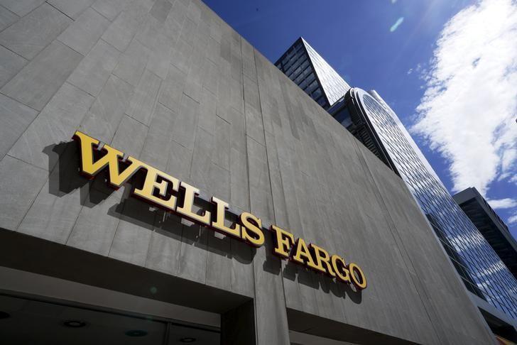 In a push upmarket, Wells Fargo gives top brokers raises in