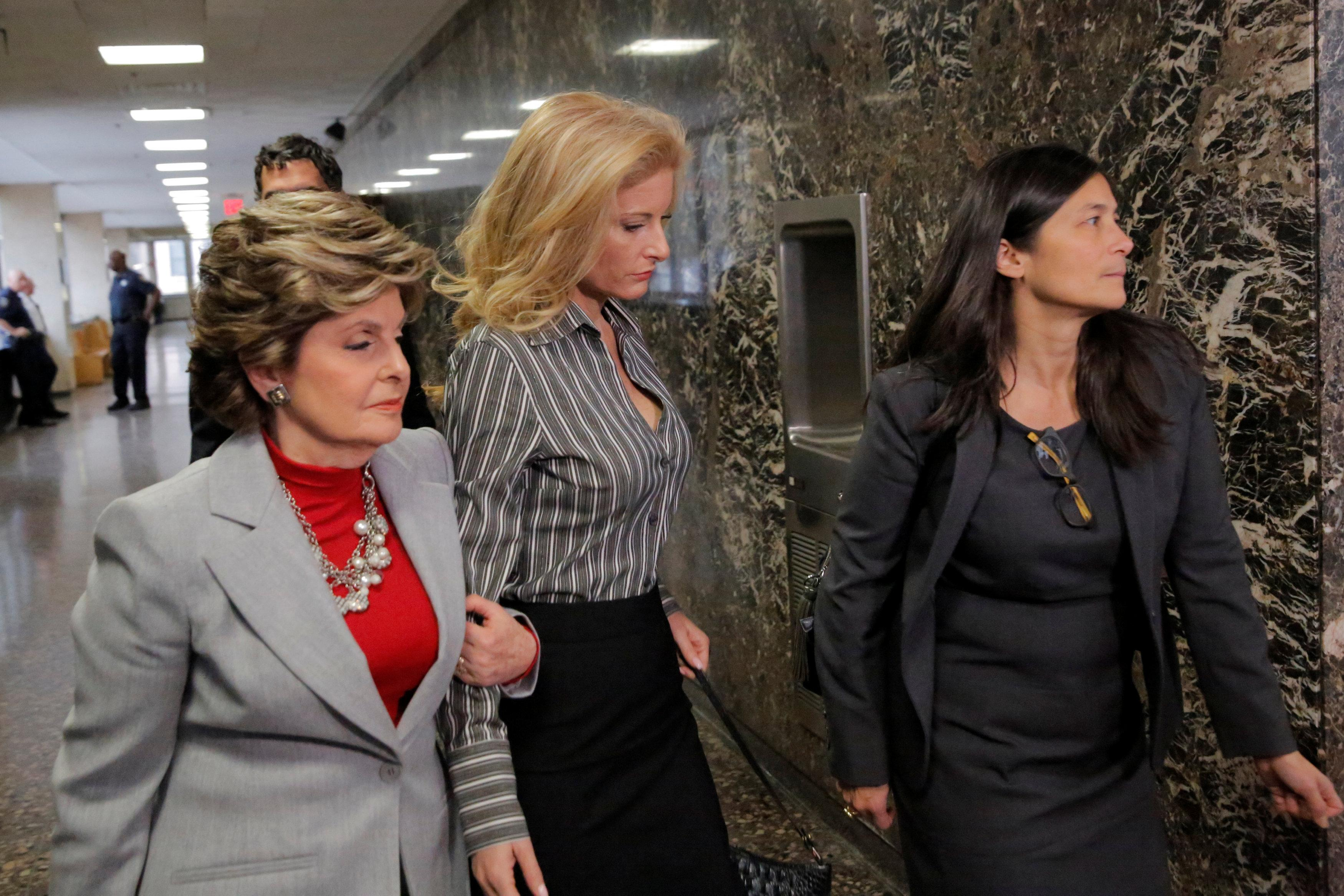 Summer Zervos (C), a former contestant on The Apprentice, arrives at New York State Supreme Court with attorney Gloria Allred (L) as a judge considers throwing out a defamation case against U.S. President Donald Trump, in Manhattan, New York City, U.S., December 5, 2017.  Andrew Kelly
