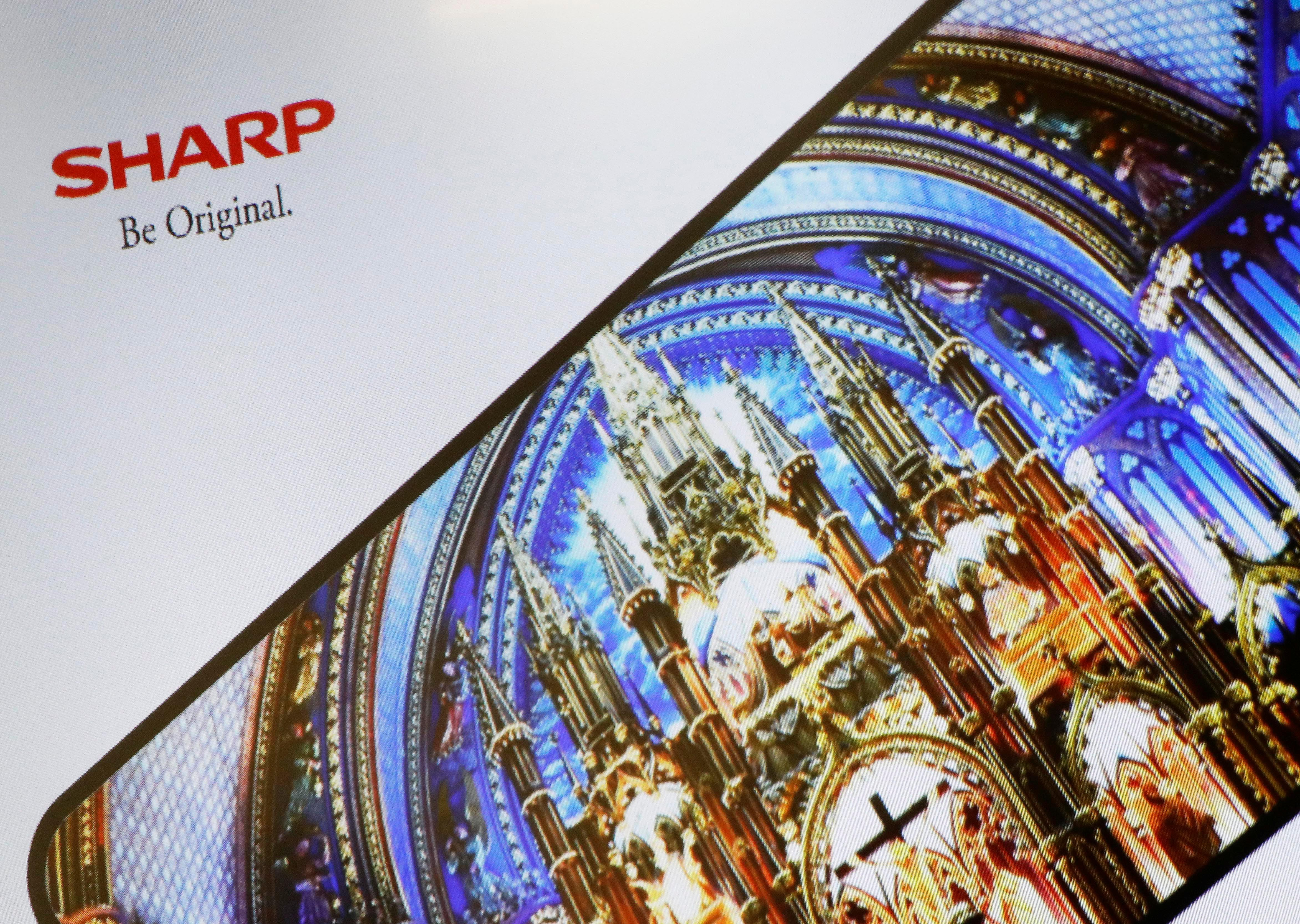 Sharp Corp's logo is pictured at its President Tai Jeng-wu's news conference in Tokyo, Japan December 7, 2017. Kim Kyung-Hoon