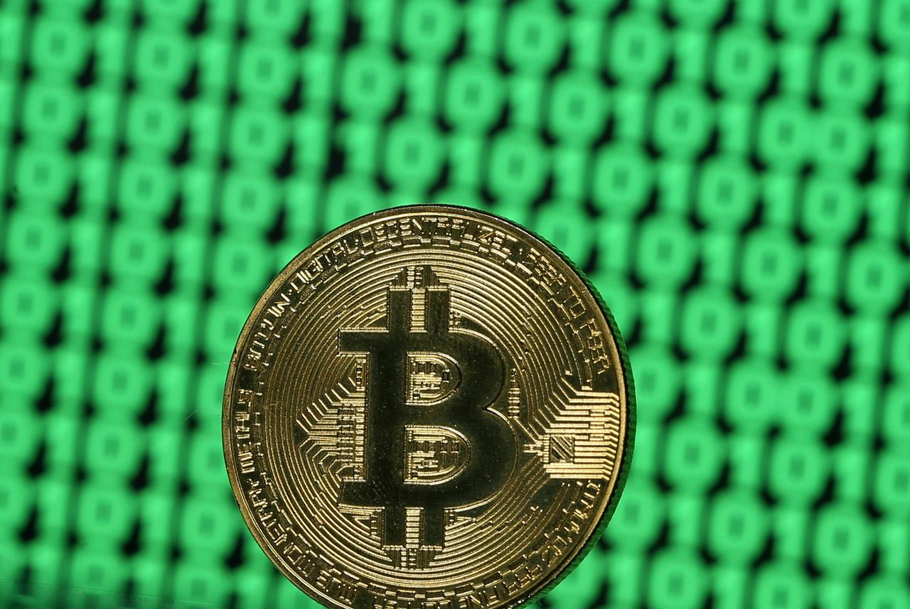 Us fund firms make new push for bitcoin etfs as futures debut file photo a token of the virtual currency bitcoin is seen placed on a monitor that displays binary digits in this illustration picture december 8 2017 buycottarizona