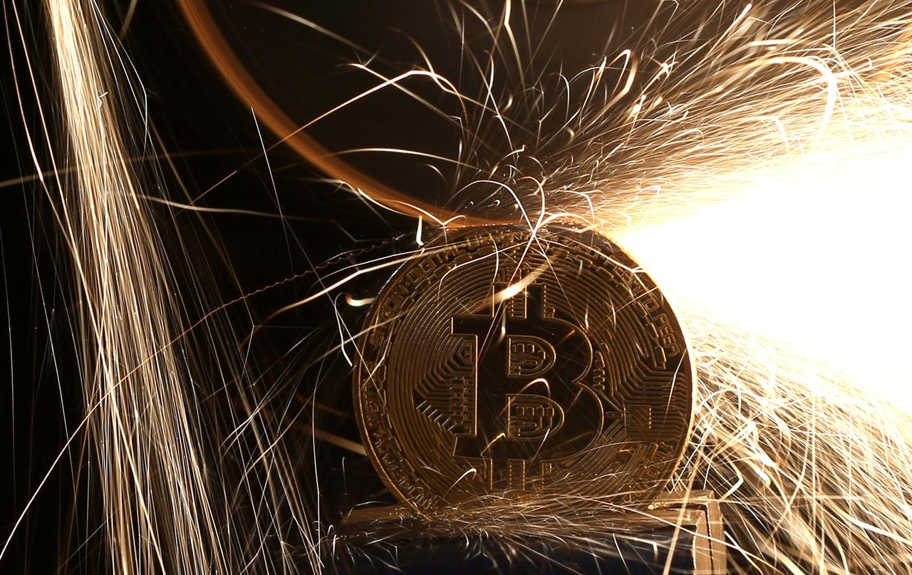 Factbox cboe launches bitcoin futures contracts cme to follow file photo sparks glow from broken bitcoin virtual currency coins in this illustration picture december 8 2017 reutersdado ruvicillustration biocorpaavc Choice Image
