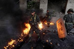 Protesters block roads in Honduras as electoral crisis rumbles on